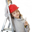Girl in the construction helmet with a screwdriver. — Stock Photo