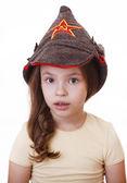 Beautiful little girl in Budenovka. — Stock Photo