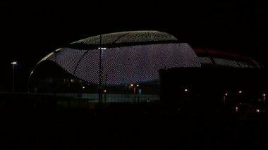"Olympic night illumination of large ice palace ""Big."" Sochi. Russia. — Stock Video"