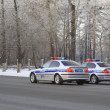 Police cars on city road. — Stock Photo #37036153
