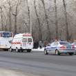Special machines escorted column. Olympic Torch Relay in Omsk. R — Stock Photo