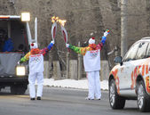 Torchbearers pass the fire. Olympic Torch Relay in Omsk. Russia. — Stock Photo
