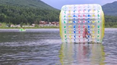 Girl in the inflatable Water Roller Balll on the lake. — Stock Video