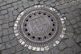 Manhole in the historical centre of Prague. — Stock Photo