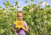 Beautiful girl in sunflowers. — Stock Photo