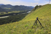Professional tripod with videography on top of the mountain. — Stock Photo