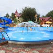 Children's pool with a fountain and a slide. — Stock Photo #48460931