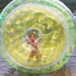 Child in inflatable attraction on the lake. — Stock Photo #48654143