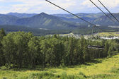 Ski lift in the summer landscape. — Stock Photo