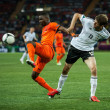 Netherlands vs Denmark in action during football match in European soccer league - Stock Photo
