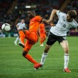 Netherlands vs Denmark in action during football match in Europesoccer league — Stock Photo #12143721