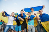 Ukrainian football fans with a Ukrainian flags — Stock Photo