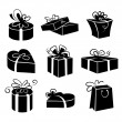 Stock Vector: Set of gift boxes icons, black and white illustrations