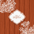 Wooden background with flowers and frame — Stock Vector #14066805