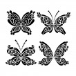 Set of beautiful black and white butterfly tattoo — Stock Vector