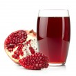 Pomegranate juice in a glass and ripe pomegranate — Stock Photo #10503128