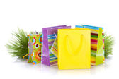 Colorful gift bags with christmas gifts — Stock Photo