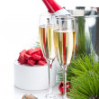 Champagne and christmas gift - Stock Photo