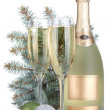 Champagne glasses, bottle, baubles and fir tree — Stock Photo
