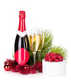 Champagne, christmas decor and gift — Stock Photo