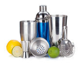 Cocktail shaker, strainer, measuring cup, drinking straws and ci — Stock Photo