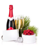 Champagne and christmas gifts — Stock Photo
