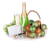 Champagne bottle, glasses, empty gift card and christmas balls — Stock Photo
