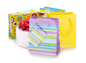 Colored gift bags and box — Stock Photo