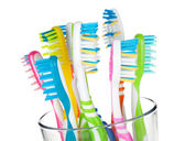 Colorful toothbrushes in glass — Stock Photo