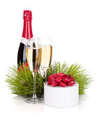 Champagne and christmas gift — Stock Photo