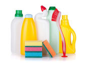 Plastic bottles of cleaning products, sponges and brush — Stock Photo