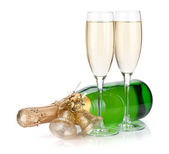 Champagne bottle with christmas decor and two glasses — Stock Photo