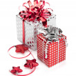Stock Photo: Two red and silver gift boxes with ribbons and christmas decor