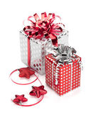 Two red and silver gift boxes with ribbons and christmas decor — Stock Photo