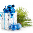 Christmas gift box and blue baubles — Stock Photo #14776305