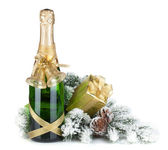 Champagne bottle, christmas gift and snowy firtree — Stock Photo