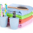 Four toothbrushes, liquid soap, hairbrush and colorful towels — Stock Photo #16278243