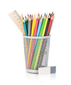 Various colour pencils with ruler and rubber — Stock Photo