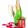 Two champagne glasses, christmas decor and rose petals — Stock Photo