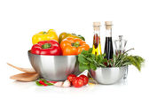 Fresh bell peppers and herbs in bowls — Stock Photo