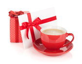 Red coffee cup, gift box and love letter with bow — Stock Photo