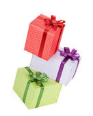 Three gift boxes with ribbon and bow — Stock Photo