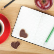 Coffee cup, cookies, red apple and office supplies — Stock Photo