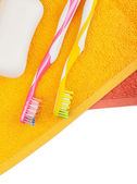 Toothbrushes, soap and two towels — Stock Photo