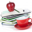 Red coffee cup, ripe apple and office supplies — Stock Photo
