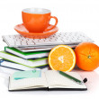 Orange fruits, coffee cup and office supplies — Stock Photo #19798327
