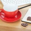 Coffee cup, cookies and office supplies — Stock Photo