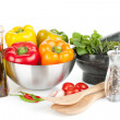 Fresh bell peppers, herbs and condiments — Stock Photo
