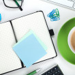 Green coffee cup and office supplies — Stock Photo