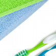 Toothbrushes and towels — Stock Photo